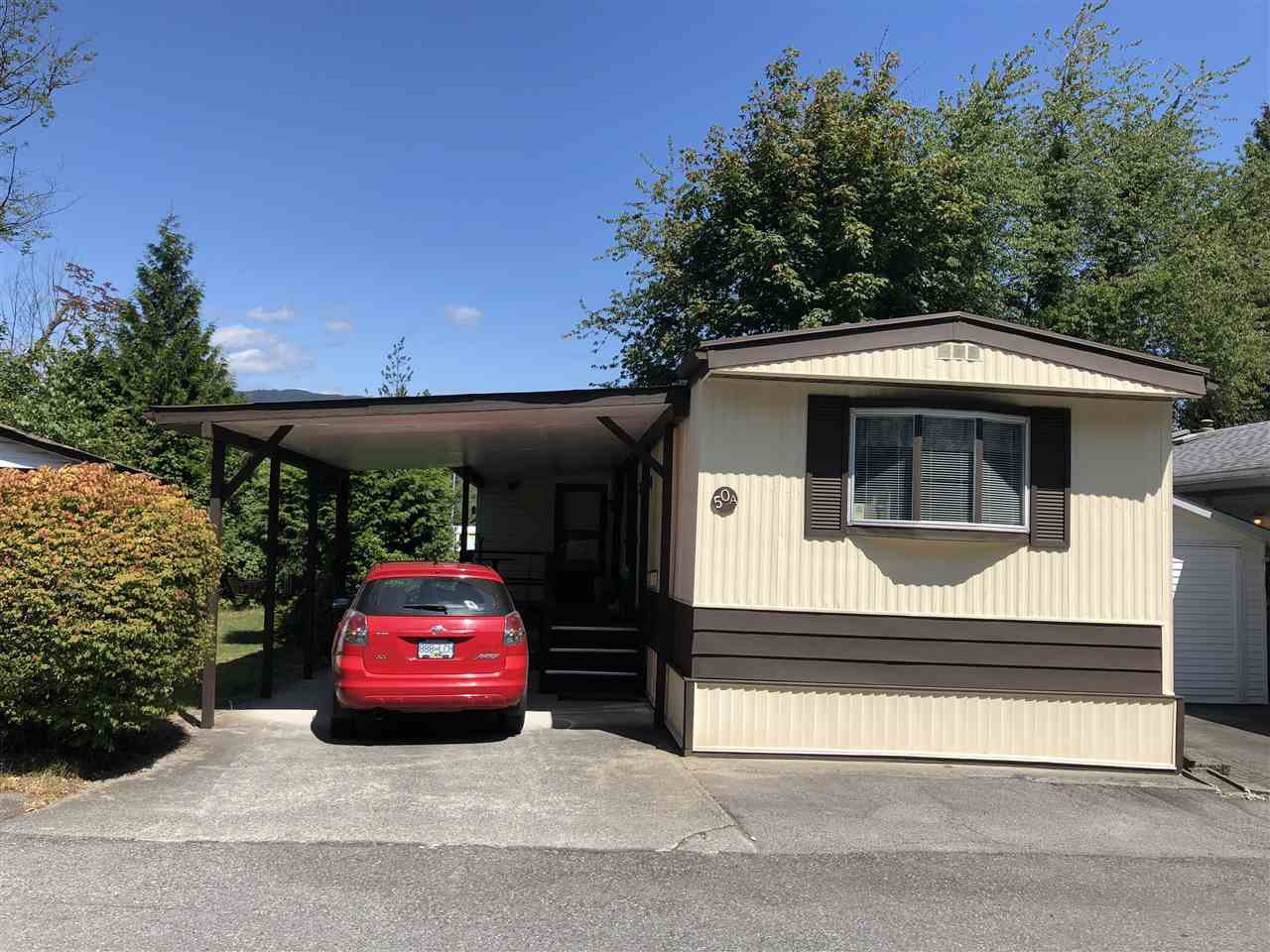 """Main Photo: 50A 4200 DEWDNEY TRUNK Road in Coquitlam: Central Coquitlam Manufactured Home for sale in """"Hideaway"""" : MLS®# R2392763"""