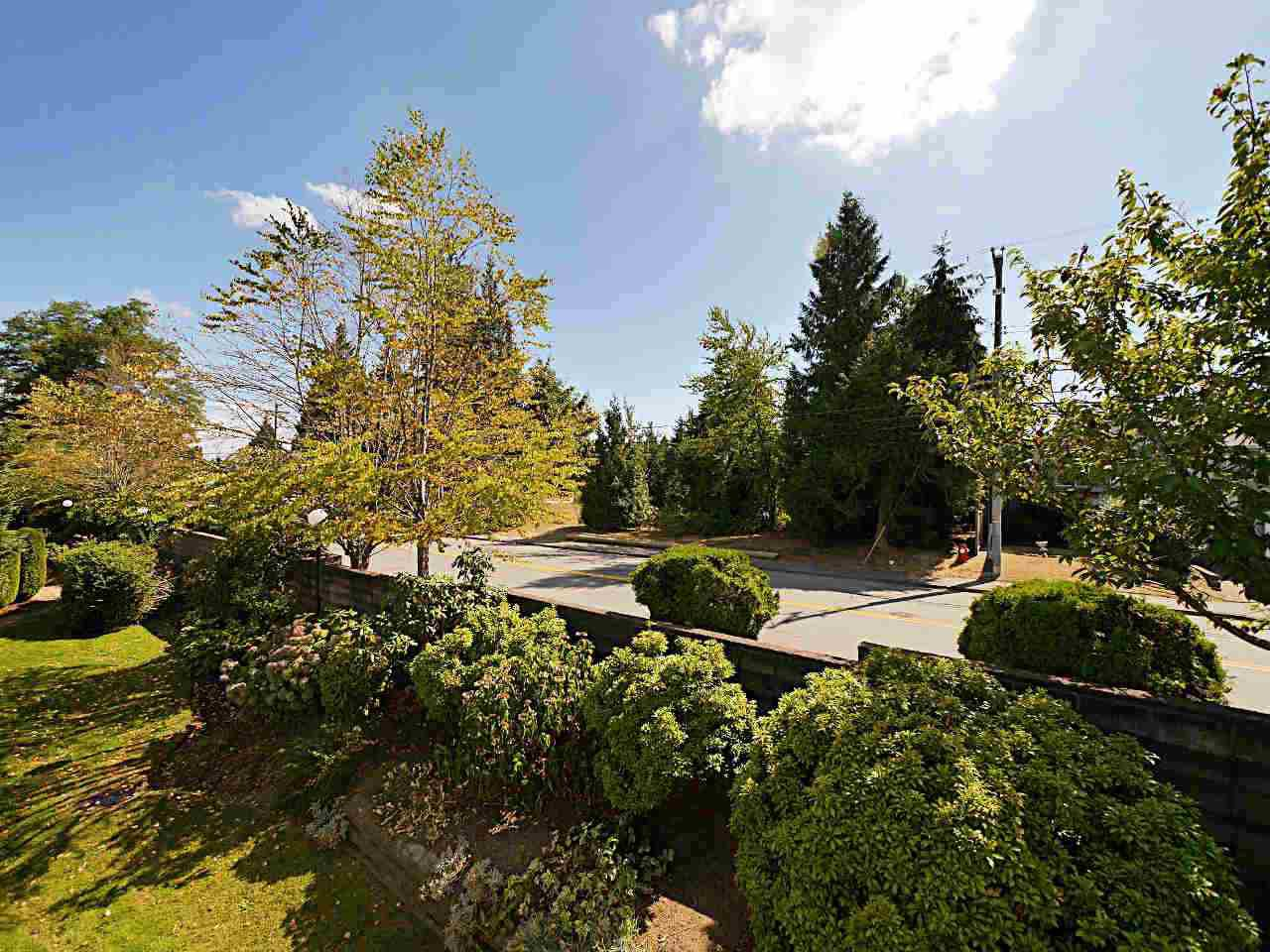 """Main Photo: 203 15153 98 Avenue in Surrey: Guildford Townhouse for sale in """"Glenwood Village at Guildford"""" (North Surrey)  : MLS®# R2200420"""
