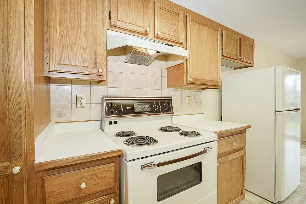 "Photo 9: Photos: 107 5641 201 Street in Langley: Langley City Townhouse for sale in ""Huntington"" : MLS®# R2222255"