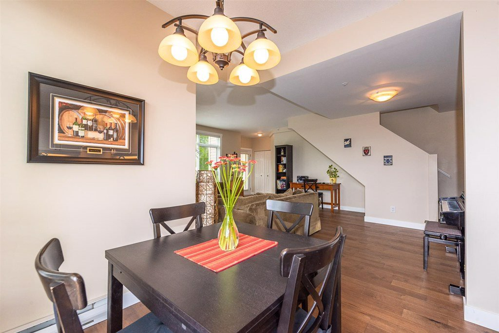 "Photo 7: Photos: 201 3600 WINDCREST Drive in North Vancouver: Roche Point Townhouse for sale in ""Windsong At Raven Woods"" : MLS®# R2377804"
