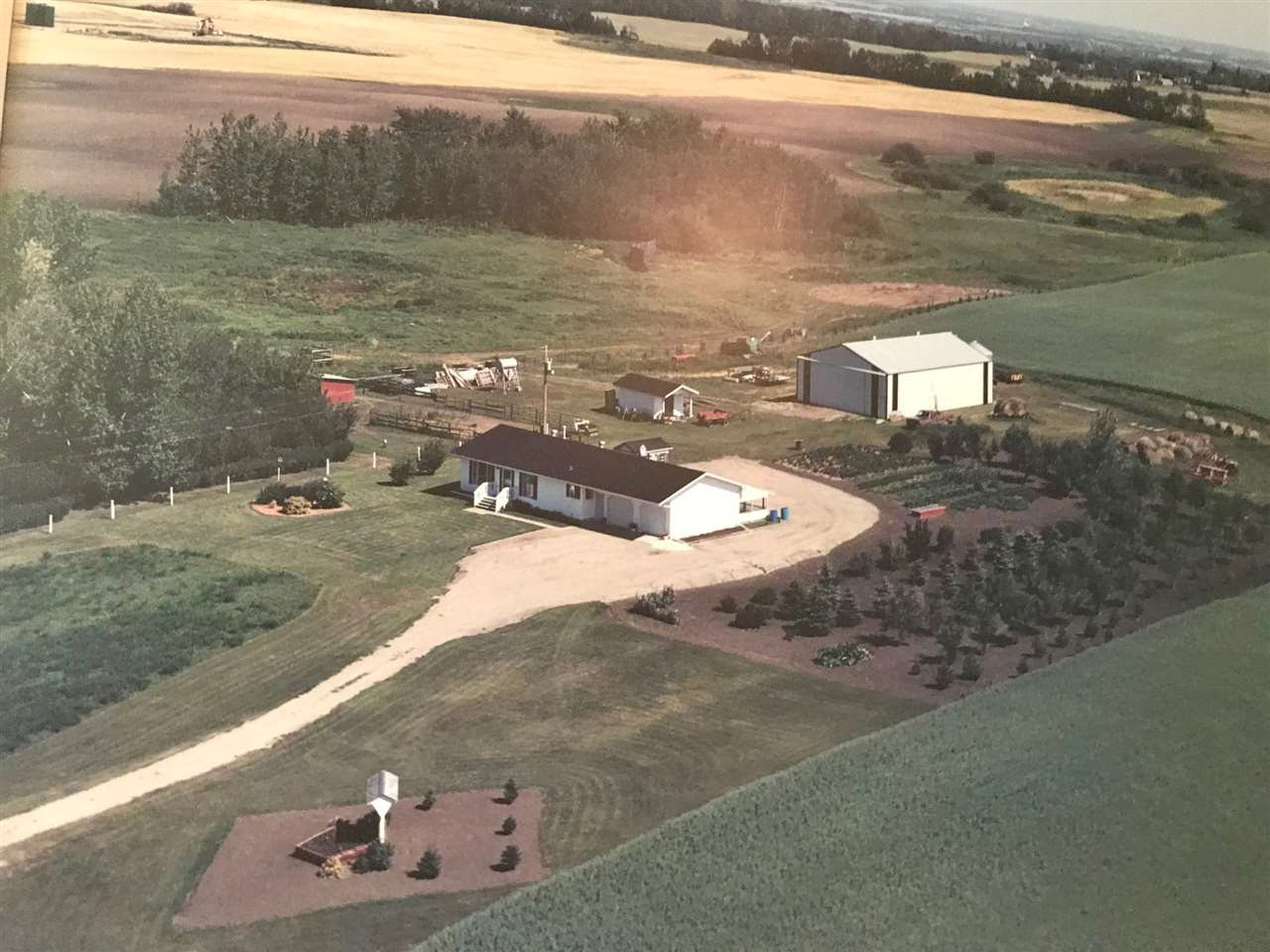 Handy location to access area plant facilities you  actual have a distant view of plants from the property. City water what a blessing on 79 acres rare find.  Paved drive leads to raised bungalow,  garage, machine shop, outbuildings, pasture, crop, etc .