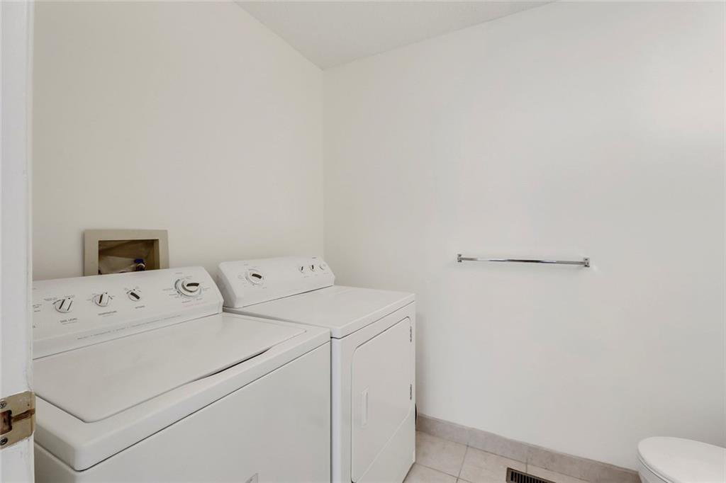 Photo 10: Photos: 232 RIVERSTONE Place SE in Calgary: Riverbend Detached for sale : MLS®# C4196523