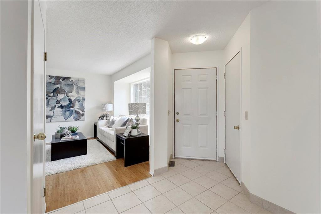 Photo 3: Photos: 232 RIVERSTONE Place SE in Calgary: Riverbend Detached for sale : MLS®# C4196523