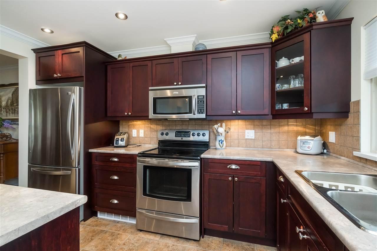 "Photo 4: Photos: 19 5960 COWICHAN Street in Sardis: Vedder S Watson-Promontory Townhouse for sale in ""Garrison Crossing"" : MLS®# R2360703"
