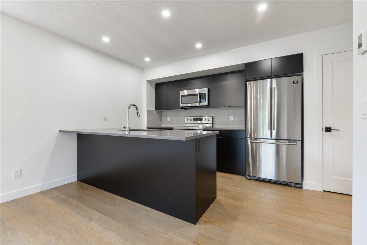 Main Photo: 1 11306 92 Street in Edmonton: Zone 05 House Half Duplex for sale : MLS®# E4204209