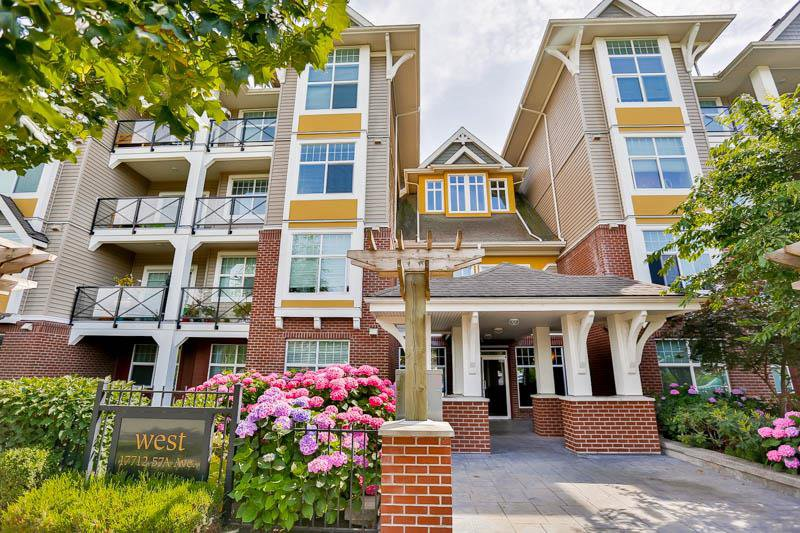 """Main Photo: 407 17712 57A Avenue in Surrey: Cloverdale BC Condo for sale in """"West on the Village Walk"""" (Cloverdale)  : MLS®# R2086740"""
