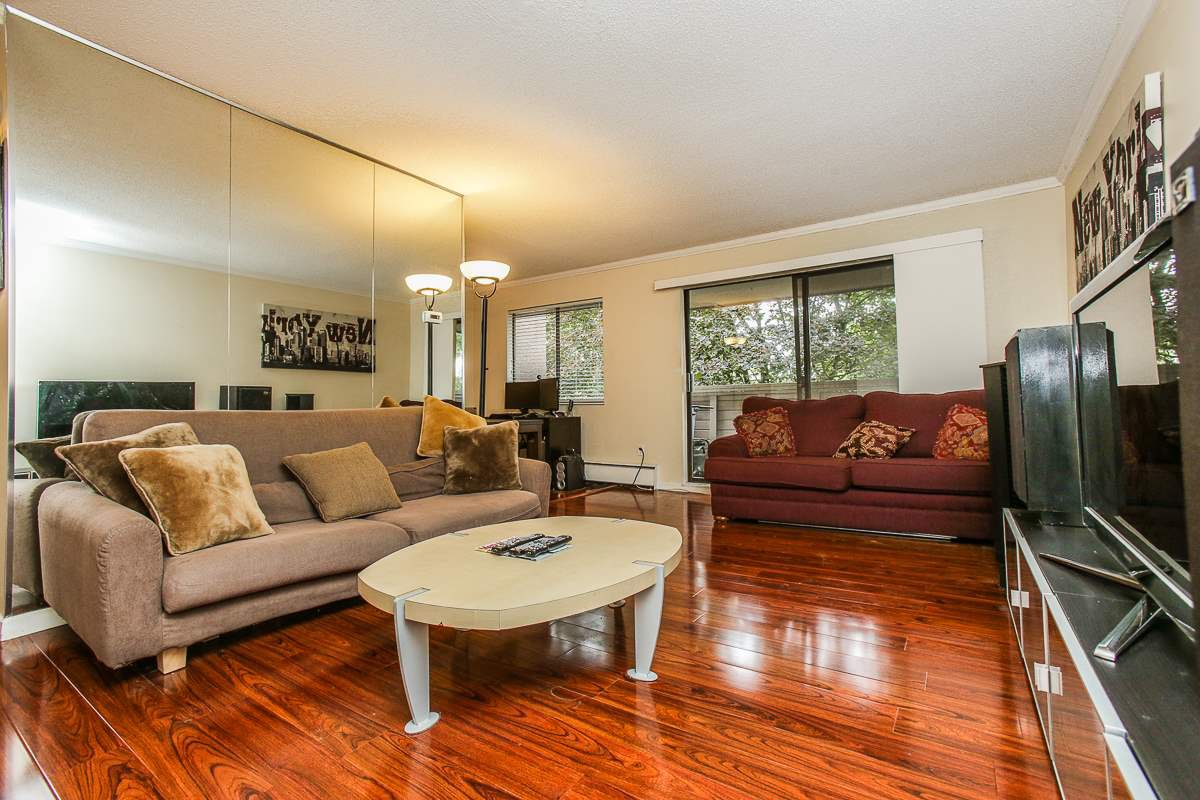 Extra large living room with gorgeous flooring and plenty of space for house sized furniture.  Sliding doors from the living room lead to large covered patio with lovely treed outlook.