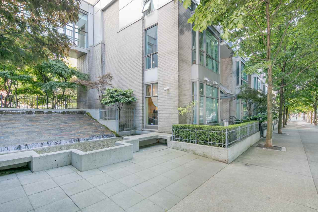 End unit, walk up townhouse in Yaletown at the Savoy