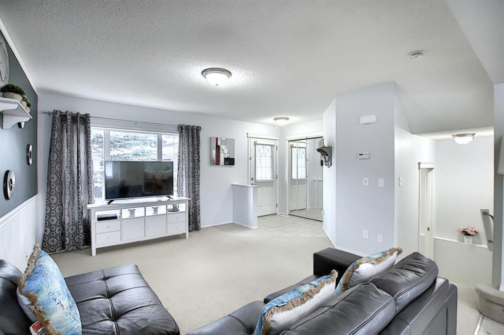 Photo 8: Photos: 646 EVERMEADOW Road SW in Calgary: Evergreen Detached for sale : MLS®# A1023171