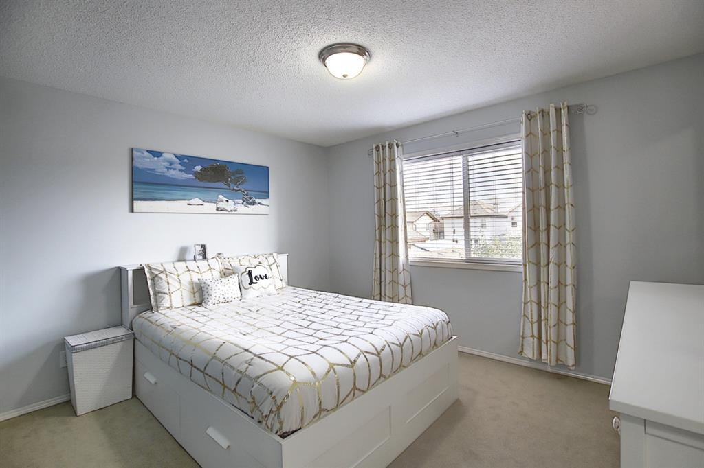 Photo 22: Photos: 646 EVERMEADOW Road SW in Calgary: Evergreen Detached for sale : MLS®# A1023171