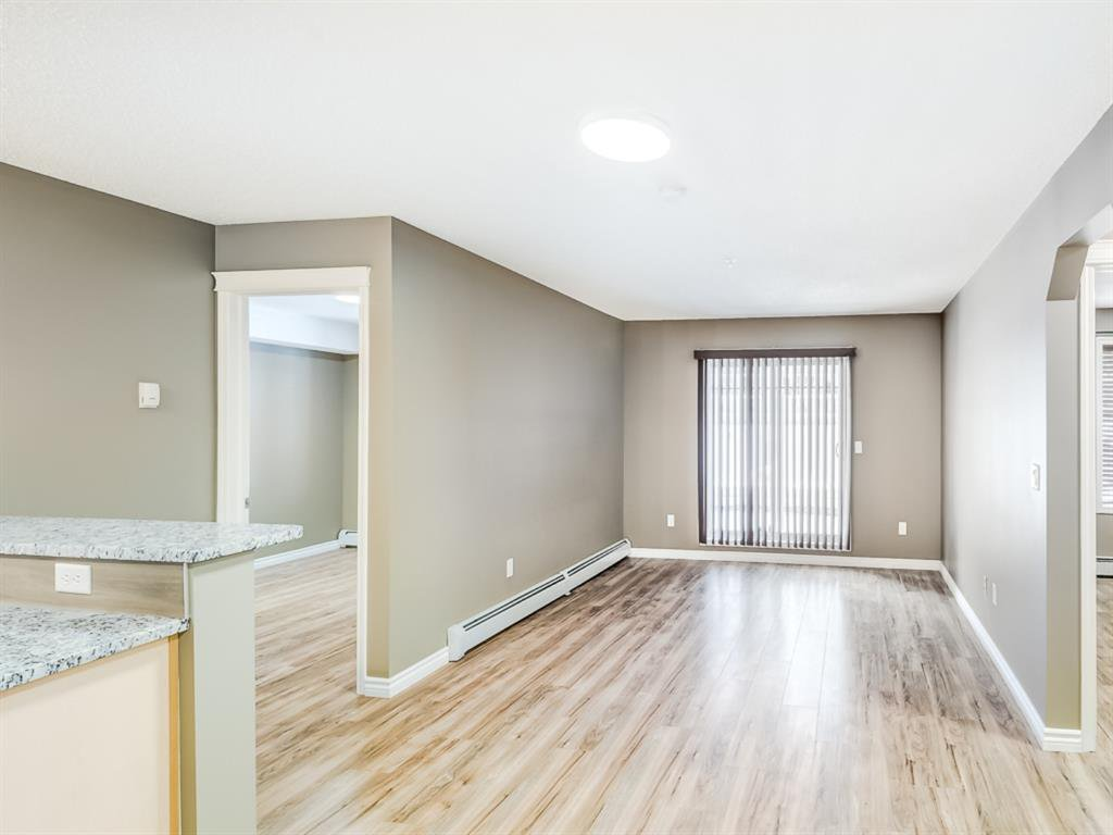 Main Photo: 4110 70 Panamount Drive NW in Calgary: Panorama Hills Apartment for sale : MLS®# A1056107