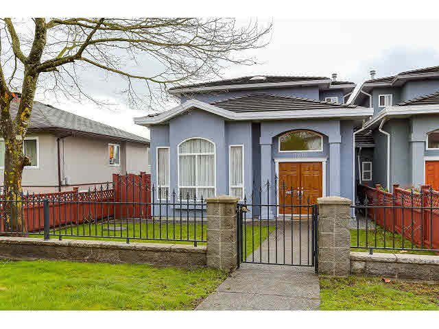 Main Photo: 7770 16TH AVE - LISTED BY SUTTON CENTRE REALTY in Burnaby: East Burnaby House 1/2 Duplex for sale (Burnaby East)  : MLS®# V1113476