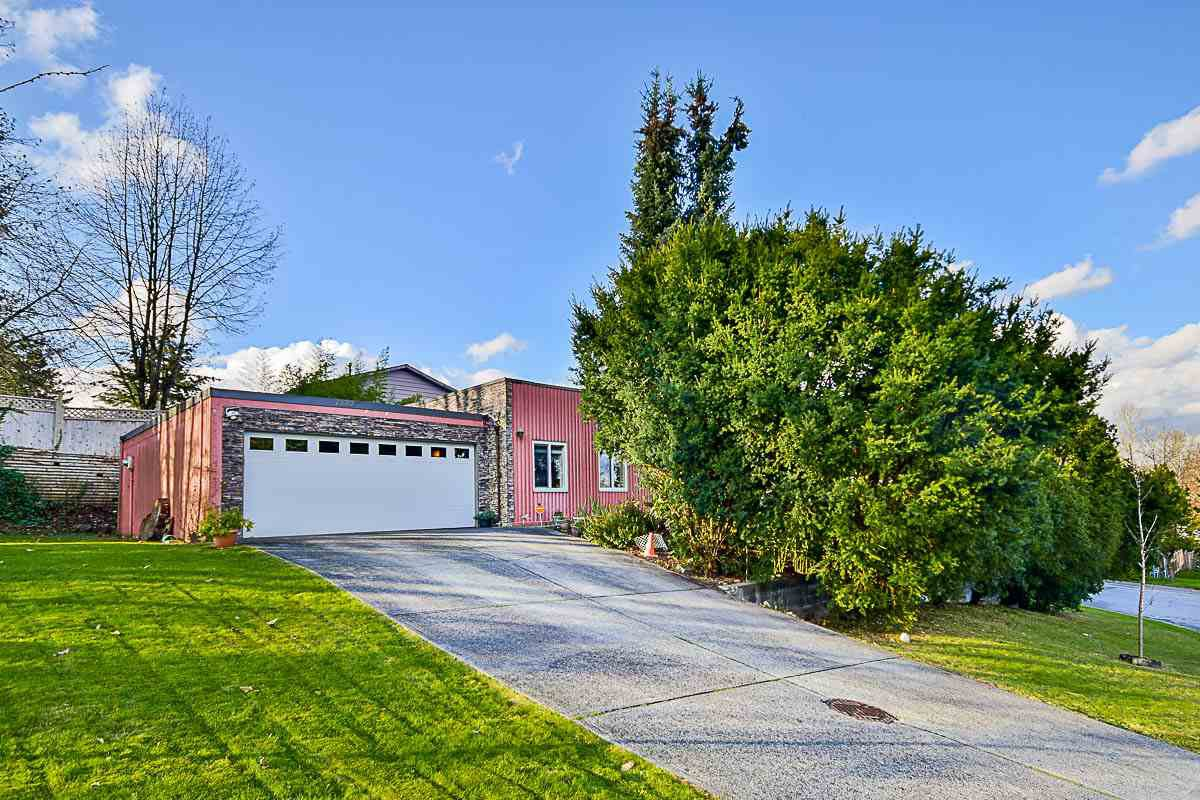 Main Photo: 7887 SUNCREST Drive in Surrey: East Newton House for sale : MLS®# R2125728