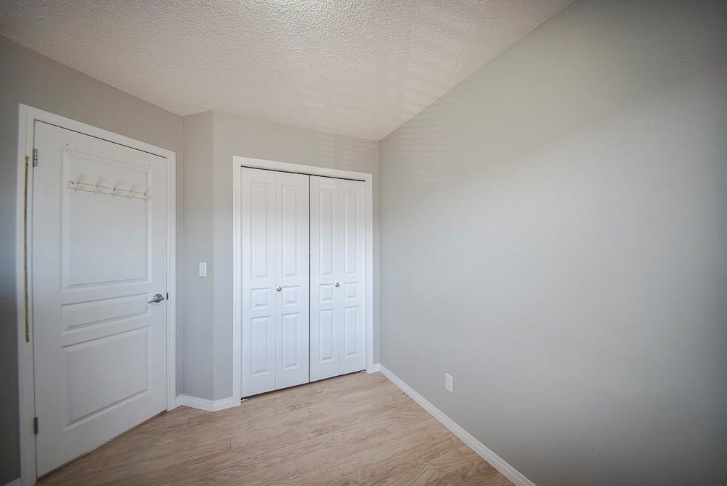 Photo 18: Photos: 35 AUBURN BAY Boulevard SE in Calgary: Auburn Bay Semi Detached for sale : MLS®# C4204478