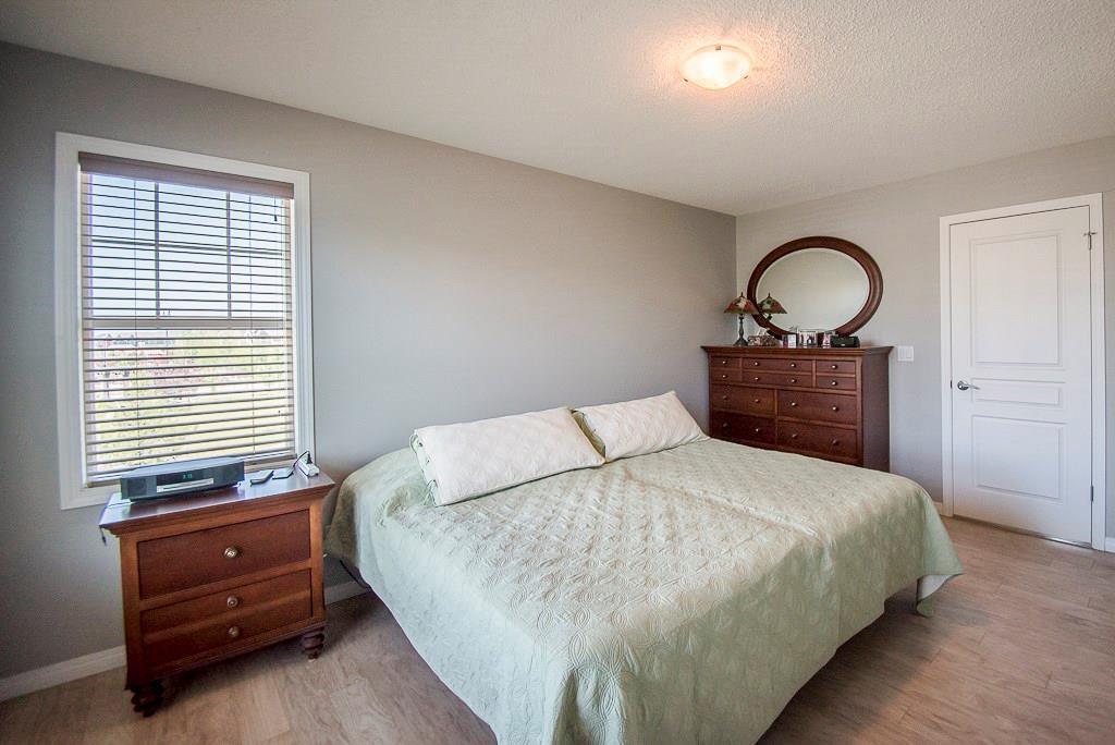 Photo 12: Photos: 35 AUBURN BAY Boulevard SE in Calgary: Auburn Bay Semi Detached for sale : MLS®# C4204478