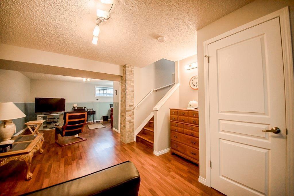 Photo 21: Photos: 35 AUBURN BAY Boulevard SE in Calgary: Auburn Bay Semi Detached for sale : MLS®# C4204478