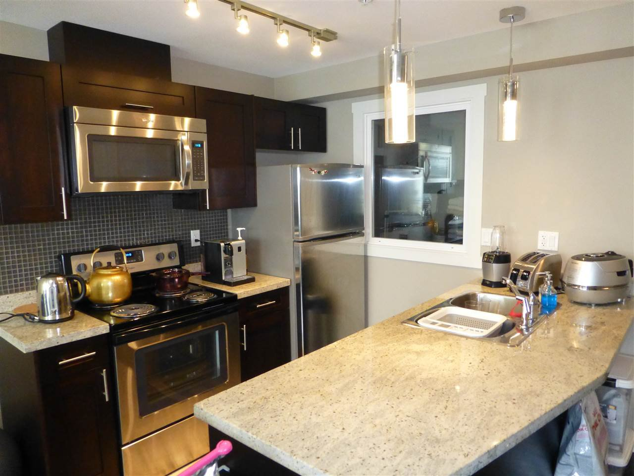 """Main Photo: 306 5488 CECIL Street in Vancouver: Collingwood VE Condo for sale in """"Cecil Hill"""" (Vancouver East)  : MLS®# R2142569"""