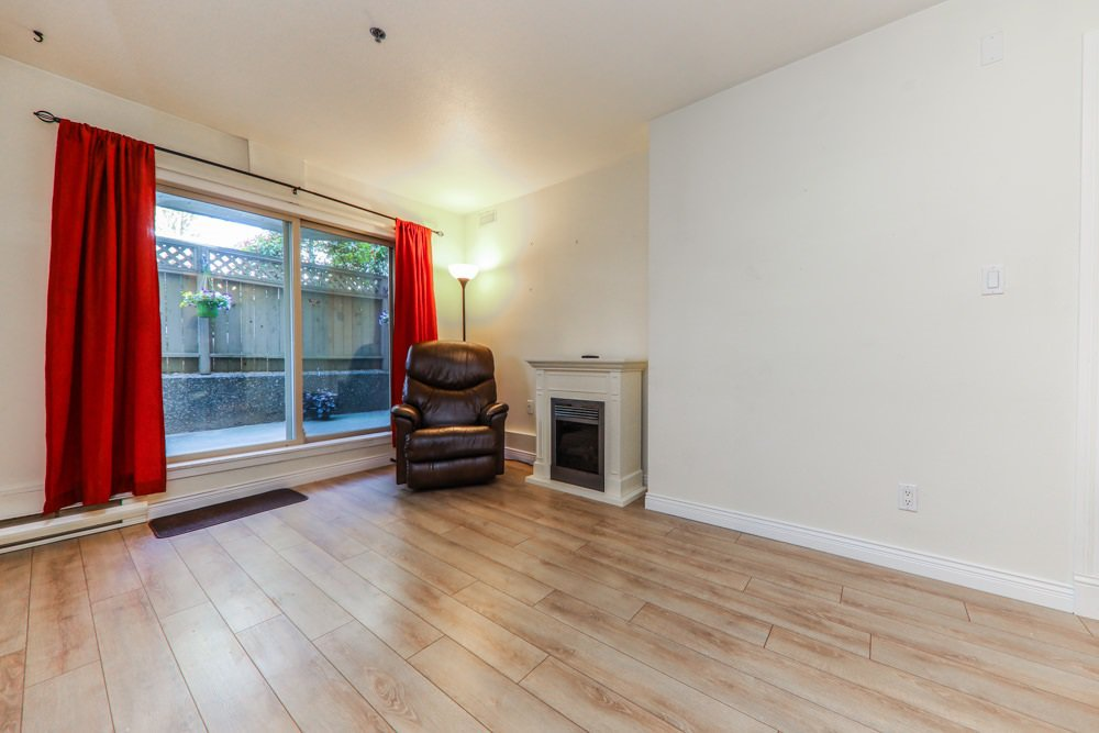 "Photo 4: Photos: 103 1516 E 1ST Avenue in Vancouver: Grandview Woodland Condo for sale in ""WOODLAND VILLA"" (Vancouver East)  : MLS®# R2370531"