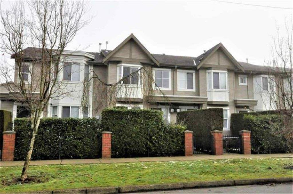 "Main Photo: 9 15450 101A Avenue in Surrey: Guildford Townhouse for sale in ""Canterbury"" (North Surrey)  : MLS®# R2384888"