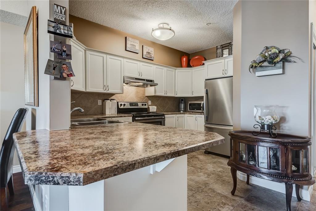 Photo 7: Photos: 210 248 SUNTERRA RIDGE Place: Cochrane Condo for sale : MLS®# C4193925