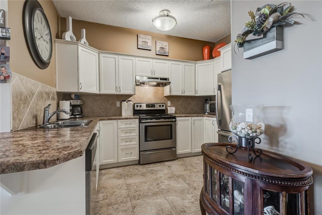 Photo 3: Photos: 210 248 SUNTERRA RIDGE Place: Cochrane Condo for sale : MLS®# C4193925
