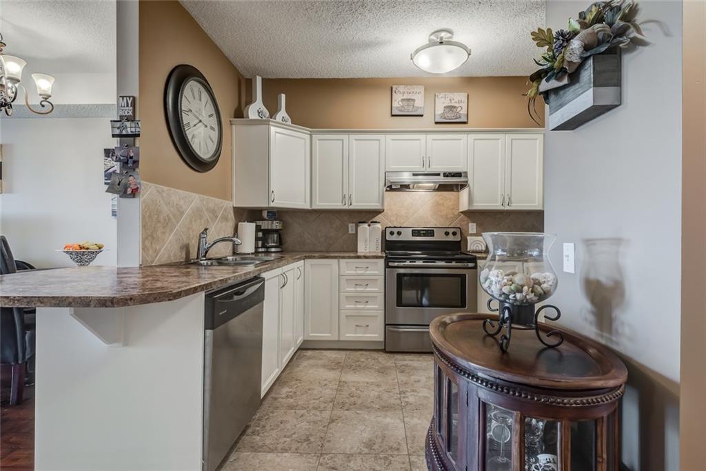 Photo 4: Photos: 210 248 SUNTERRA RIDGE Place: Cochrane Condo for sale : MLS®# C4193925