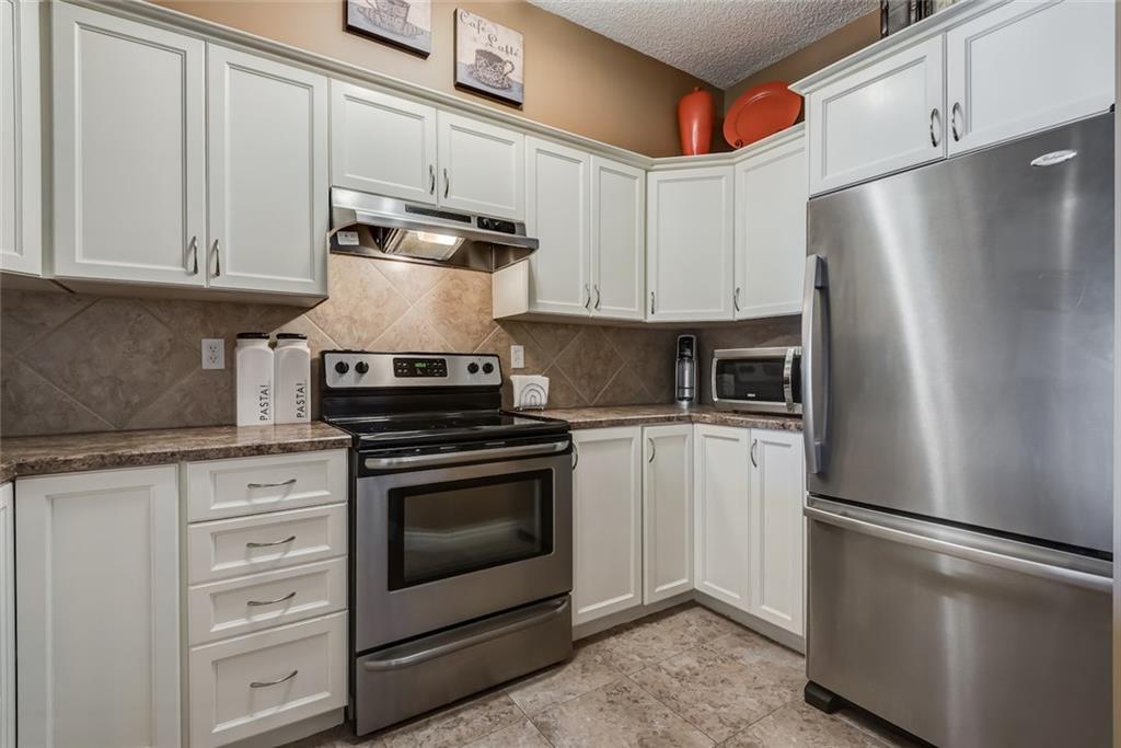 Photo 5: Photos: 210 248 SUNTERRA RIDGE Place: Cochrane Condo for sale : MLS®# C4193925