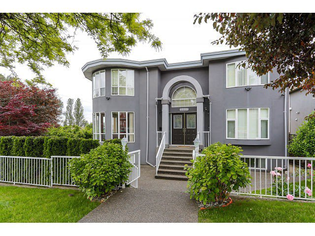 Main Photo: 7687 MARY AVE - LISTED BY SUTTON CENTRE REALTY in Burnaby: Edmonds BE House for sale (Burnaby East)  : MLS®# V1126167
