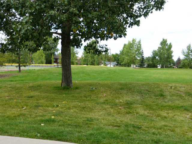 Main Photo: 1212 200 BROOKPARK Drive SW in Calgary: Braeside_Braesde Est Townhouse for sale : MLS®# C3643663