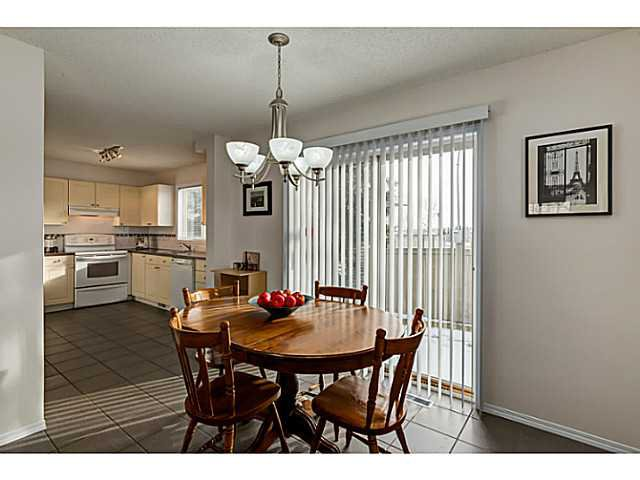Photo 7: Photos: 127 HARVEST GOLD Place NE in Calgary: Harvest Hills Townhouse for sale : MLS®# C3653395
