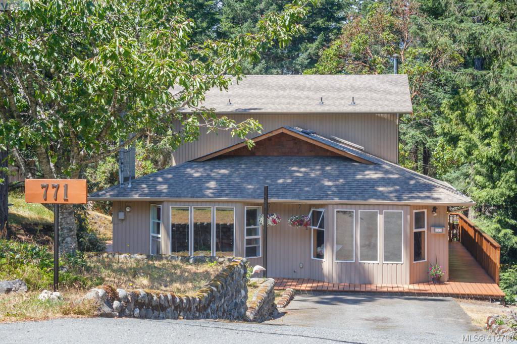 Family size home situated in a private treed oasis.