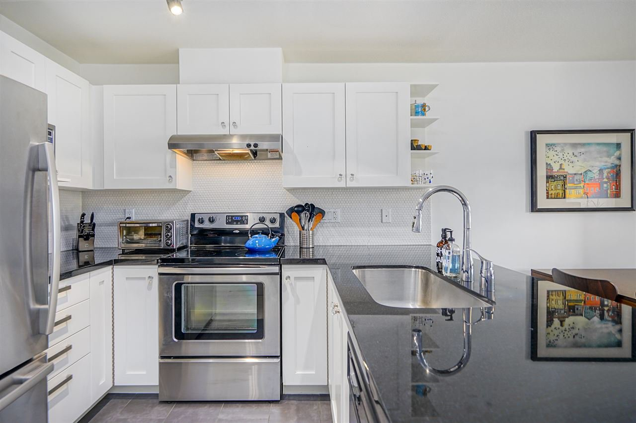 """Main Photo: 211 738 E 29TH Avenue in Vancouver: Fraser VE Condo for sale in """"CENTURY"""" (Vancouver East)  : MLS®# R2399578"""