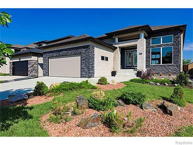 67 Portside Dr. Professionally landscaped. Stone & stucco exterior, triple pane windows, stainless steel accents