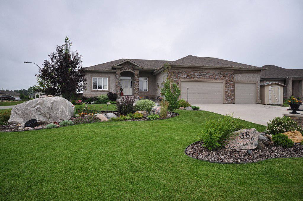 PRIDE OF OWNERSHIP! Custom Built 1571 sf R&B Open Concept Bungalow offering a total of 5 Bedrooms & 3 Baths on an Exceptionally Beautiful Landscaped Lot in the Town of Oakbank.