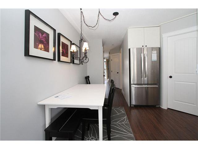 "Main Photo: # 213 2010 W 8TH AV in Vancouver: Kitsilano Condo for sale in ""AUGUSTINE GARDENS"" (Vancouver West)  : MLS®# V880530"