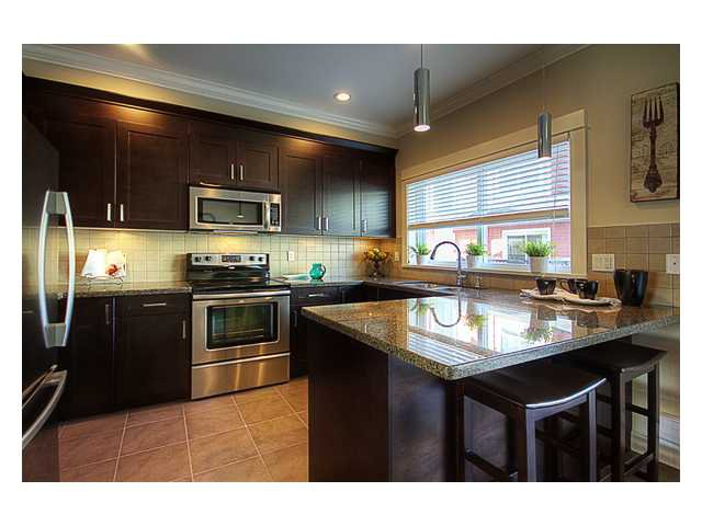 """Main Photo: 11 1130 EWEN Avenue in New Westminster: Queensborough Townhouse for sale in """"GLADSTONE PARK"""" : MLS®# V942287"""