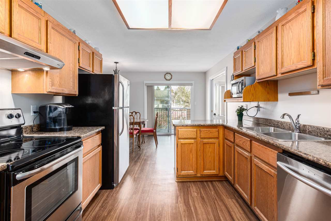 """Main Photo: 232 5641 201 Street in Langley: Langley City Townhouse for sale in """"THE HUNTINGTON"""" : MLS®# R2461702"""