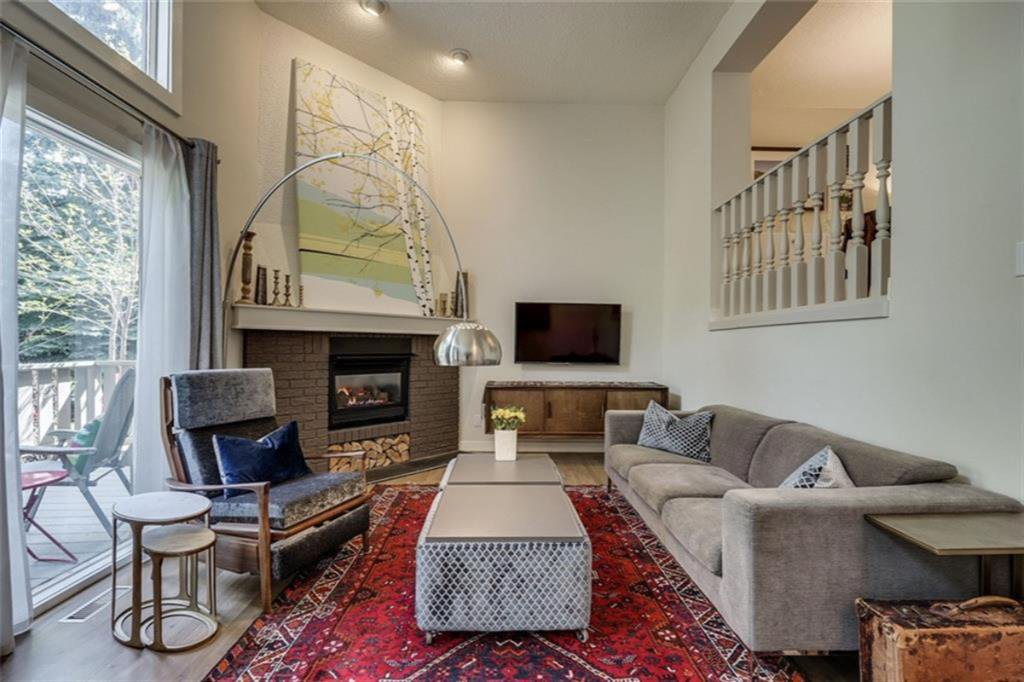 Soaring ceilings, gas fireplace, knock down ceilings and space galore!