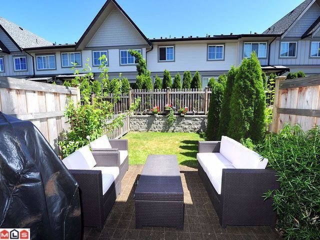 "Main Photo: 110 2501 161A Street in Surrey: Grandview Surrey Townhouse for sale in ""HIGHLAND"" (South Surrey White Rock)  : MLS®# F1304747"