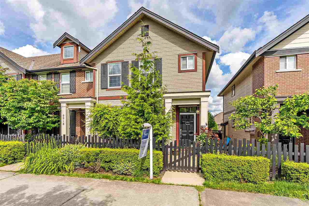 Main Photo: 6916 208 Street in Langley: Willoughby Heights Condo for sale : MLS®# R2479766