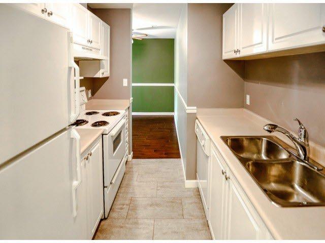 "Main Photo: 114 7505 138TH Street in Surrey: East Newton Condo for sale in ""Midtown Villa"" : MLS®# F1417804"