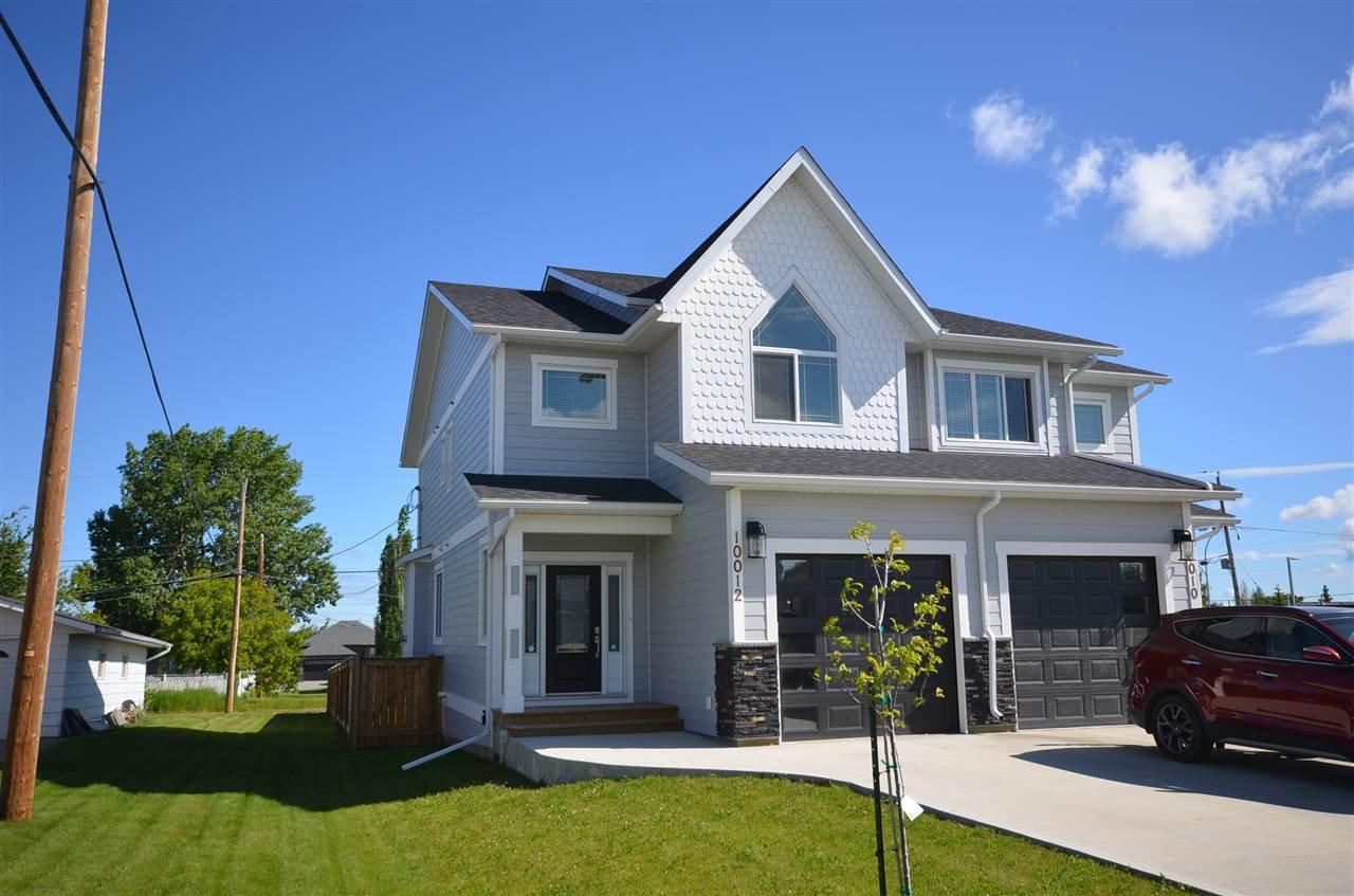 Main Photo: 10012 111 Avenue in Fort St. John - Rural W 100th: Fort St. John - City NW House 1/2 Duplex for sale (Fort St. John (Zone 60))  : MLS®# R2469597