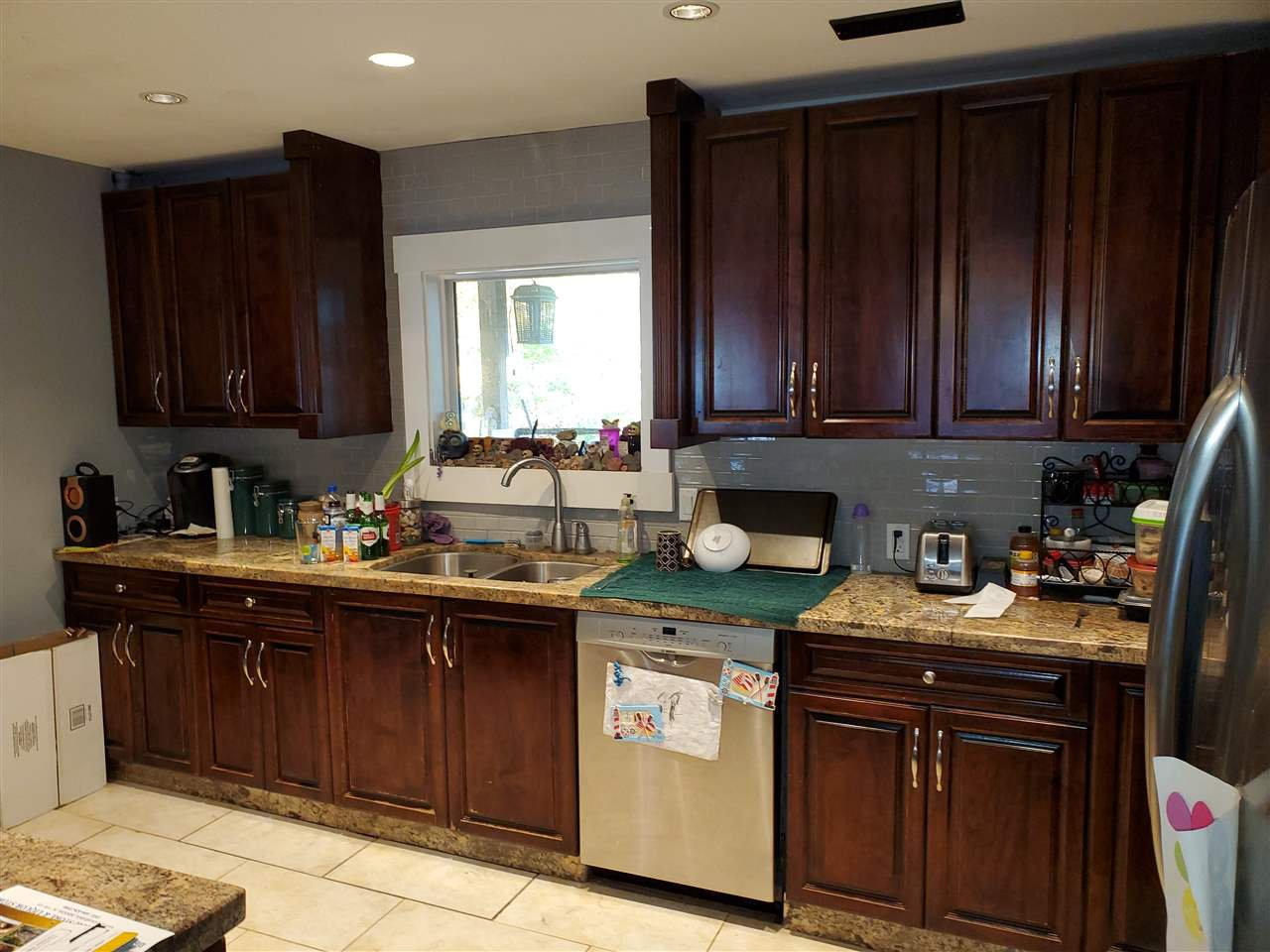 Kitchen with lots of Cabinets & Granite Counters
