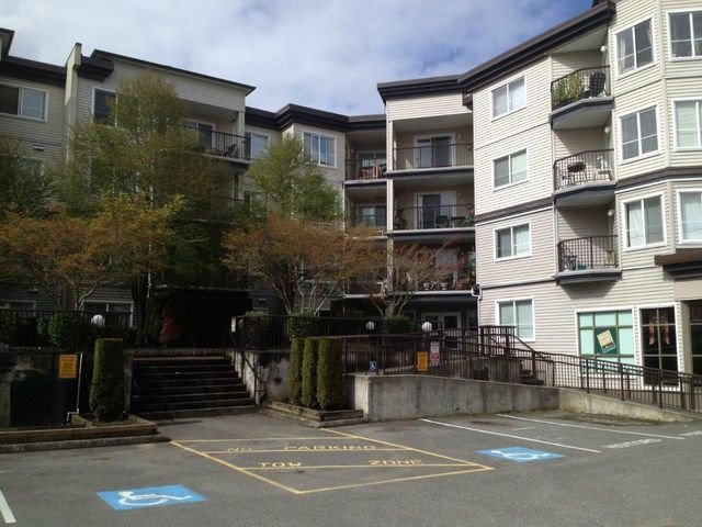 "Main Photo: 404 5765 GLOVER Road in Langley: Langley City Condo for sale in ""College Court"" : MLS®# F1308821"