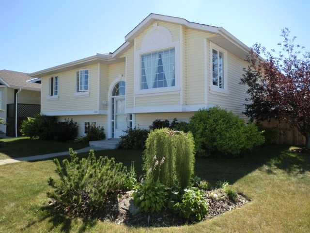 Main Photo: 119 QUIGLEY Drive: Cochrane Residential Detached Single Family for sale : MLS®# C3536407