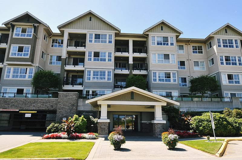 "Main Photo: 425 19673 MEADOW GARDENS Way in Pitt Meadows: North Meadows PI Condo for sale in ""THE FAIRWAYS"" : MLS®# R2392845"
