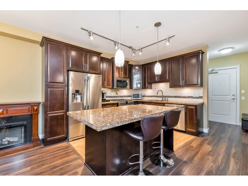 "Main Photo: 214 8157 207 Street in Langley: Willoughby Heights Condo for sale in ""Yorkson Creek - Parkside 2 - Building B"" : MLS®# R2527561"