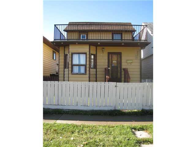 Main Photo: 123 18 Avenue NW in CALGARY: Tuxedo Residential Detached Single Family for sale (Calgary)  : MLS®# C3537596