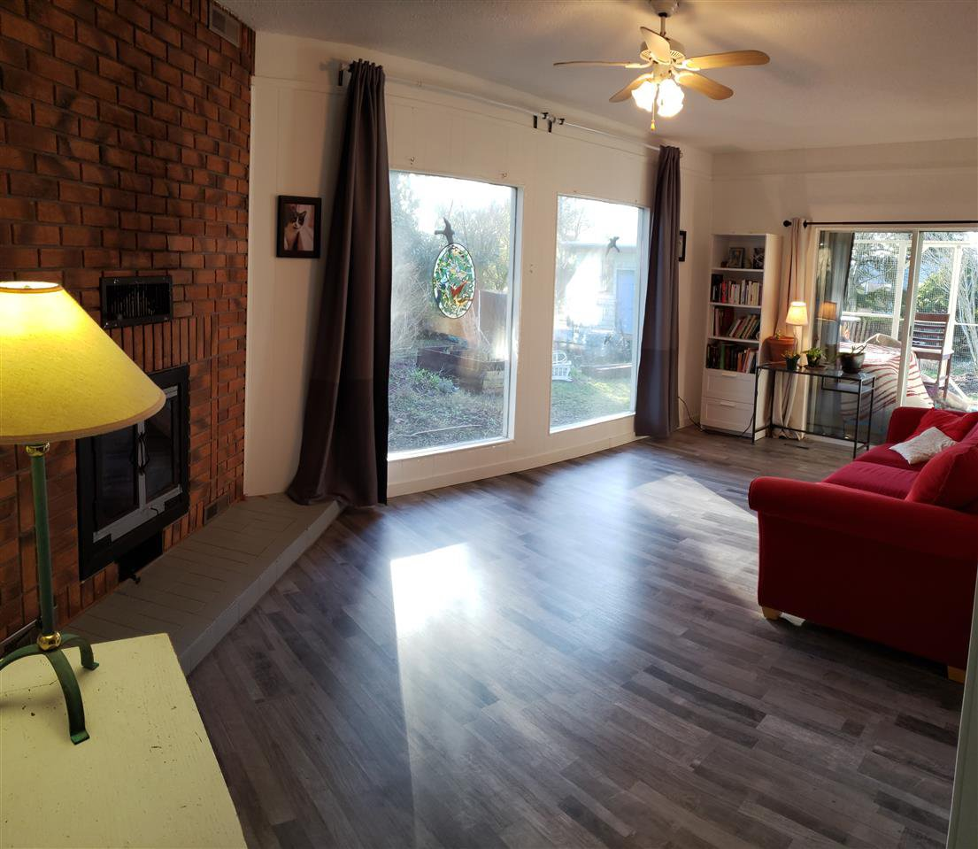 Great room!  Bright with sliding glass doors to patio/deck.  New flooring too!