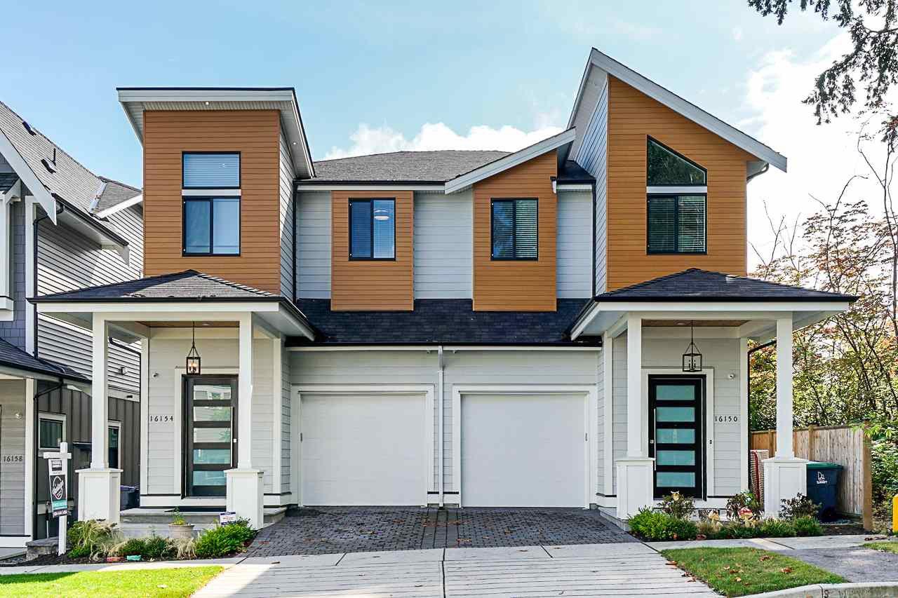 Main Photo: 16154 87 Avenue in Surrey: Fleetwood Tynehead House 1/2 Duplex for sale : MLS®# R2400935